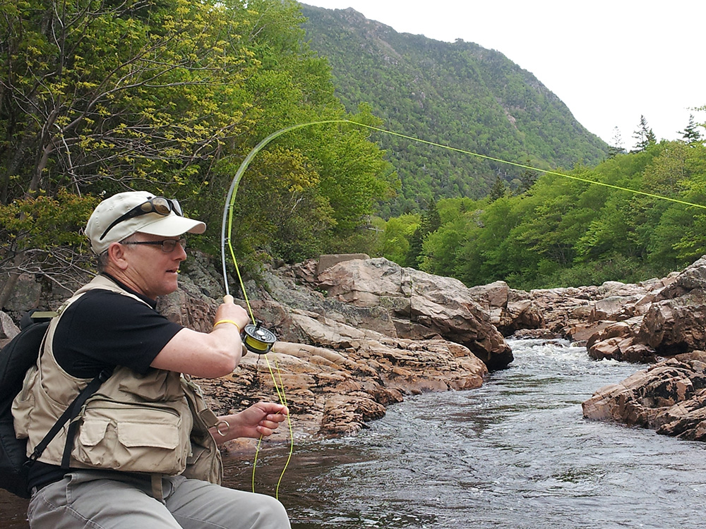 René Aucoin, President of NSSA, seen angling yesterday, June, on the Cheticamp River in Cape Breton. (Photo Lewis Hinks/ASF).