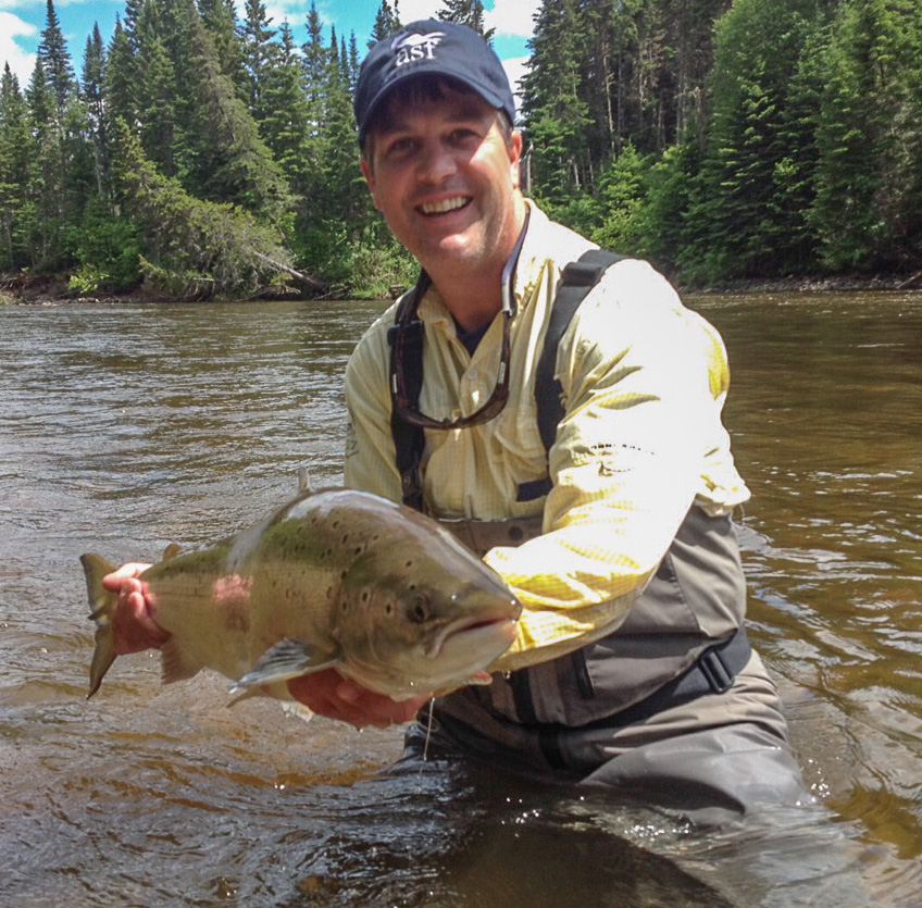 On Wed., June 25, Steve O'Brien, ASF (US) Director, prepares to release an 18 lb. salmon in the Montgomery Pool of the Grand Cascapedia River in Gaspe.