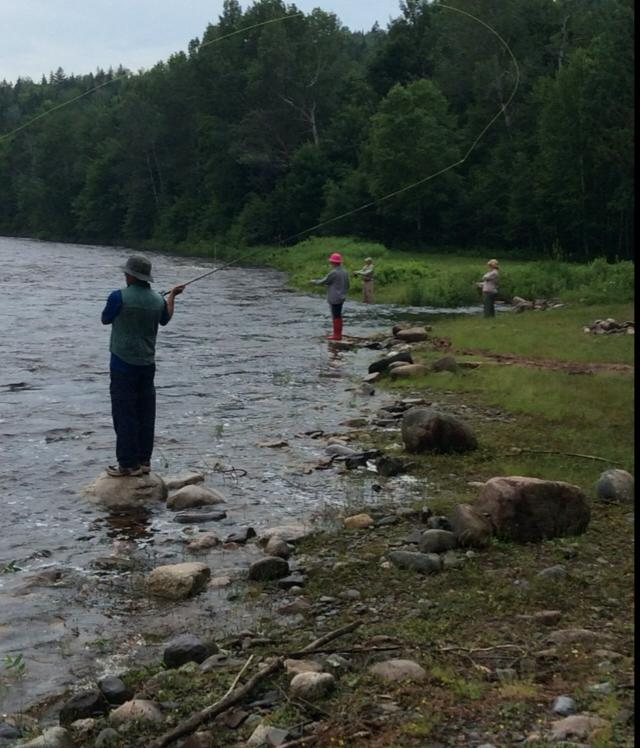 Anglers fishing from shore at Gilman Brook this week where the river was very high and fast following Arthur's visit.  Photo credit:  Lisa Gribbons.