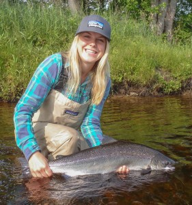 Kelsey Taylor releases an Atlantic salmon on the Southwest Miramichi, July 20, 2014.
