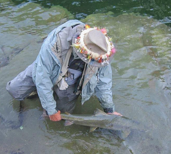 Lewis Hinks releasing an Atlantic salmon on the York River, QC. Photo Carl Purcell