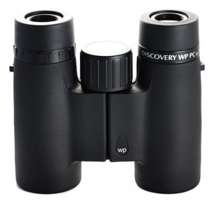 Opticron Discovery WP PC 8x32 are only 14 oz., and just 4.3 x 4.6 in., but too big for a vest pocket. Tackle Box size instead.