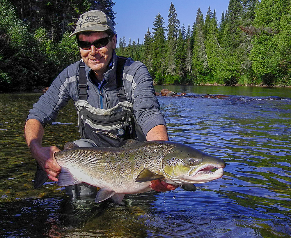 Richard Barbacki releases an Atlantic salmon in July at the Alder Pool on the Cascapedia.